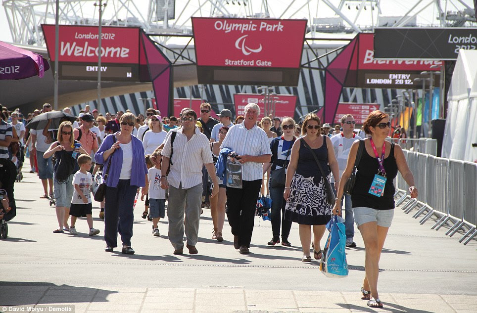 Full house: Spectators stream into the Olympic Park for Sunday night's Paralympic closing ceremony. Some 80,000 tickets have been sold for the showpiece finale