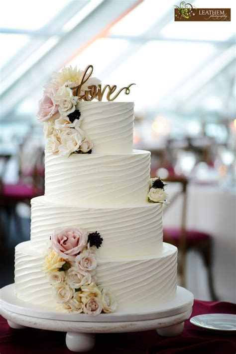 Gorgeous textured buttercream wedding cake adorned with