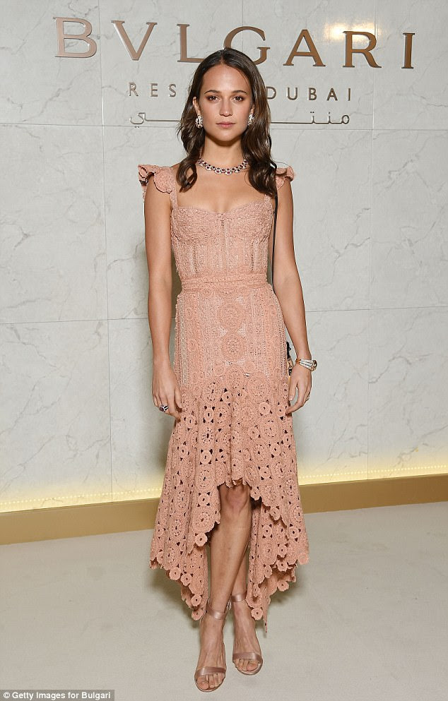 Pretty in pink: The supermodel was joined by actress Alicia Vikander, 29, who stunned in a romantic rosy low-high lacy frock for the star-studded affair.