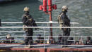 AP Exclusive: Captain feared death in migrant hijack at sea