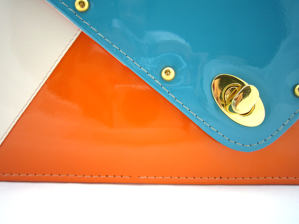http://cdn.shopify.com/s/files/1/0108/9432/products/linaenvelopeturquoisecloseup_grande.png?74