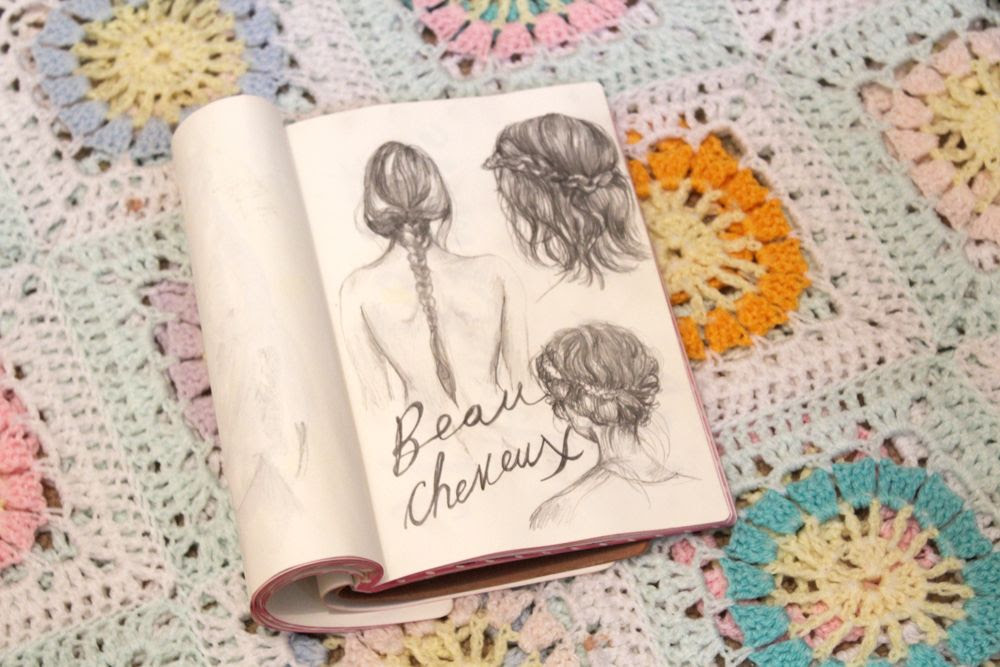 Sketches of hair in sketchbook