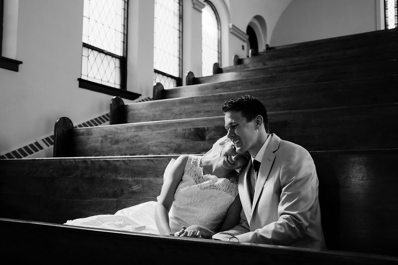Candid Preparation and pre-ceremony photography at Eagle Ridge Resort before Morgan & John's wedding in downtown Galena at St. Mary's Catholic Church.Wedding photographer– Ryan Davis Photography – Rockford, Illinois.