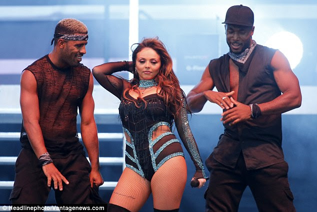 Fun and games: Jesy seemed to be enjoying herself as she threw some shapes alongside two backing dancers