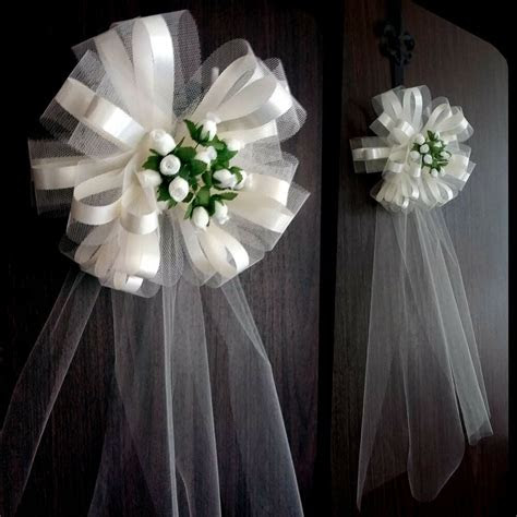 large  ivory wedding pew bows church decorations