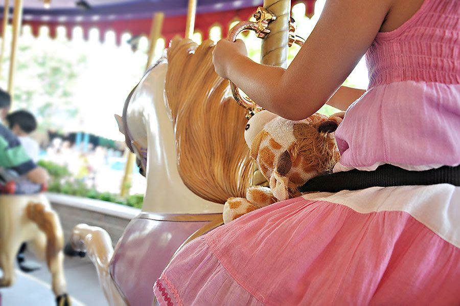 9.18, My daughter took Gerald the Giraffe for a ride on the carousel with her, making sure that he was buckled in tightly.