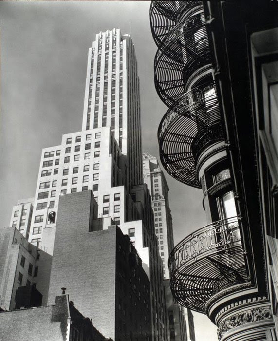 Murray Hill Hotel, from Park Avenue and 40th Street, Manhattan. Looking up past fire escapes on hotel toward large light colored building, other buildings.