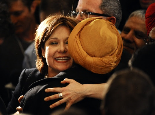 Christy Clark hugs a supporter as she makes her way through the crowd after being named the new leader of the BC Liberal party at the Liberal leadership election at the Vancouver Convention Centre on Saturday, February 26, 2011.