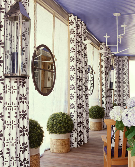 overed deck-patio with beaboard ceiling painted purple hanging mirrors white chandelier