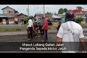 VIDEO: Suami Istri Jatuh di Lubang Galian Jalan Dua Jalur