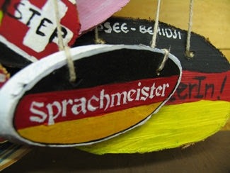<p>Villagers who successfully use their <i>Deutsch </i>to become a <i>Sprachmeister </i>are rewarded at <i>Café Einbeck</i> or at <i>Waldsee's </i>own German store—<i>der Laden</i>.</p>