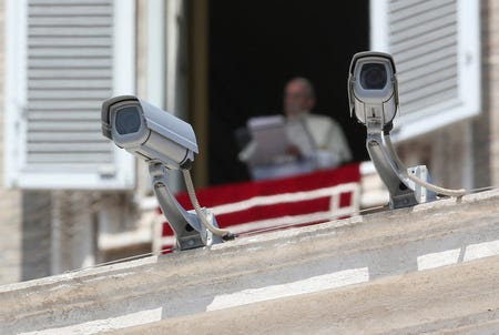FILE PHOTO: Security cameras are seen in front of Pope Francis as he leads a Sunday Angelus prayer in Saint Peter's square at the Vatican, August 20, 2017.  REUTERS/Alessandro Bianchi/File photo