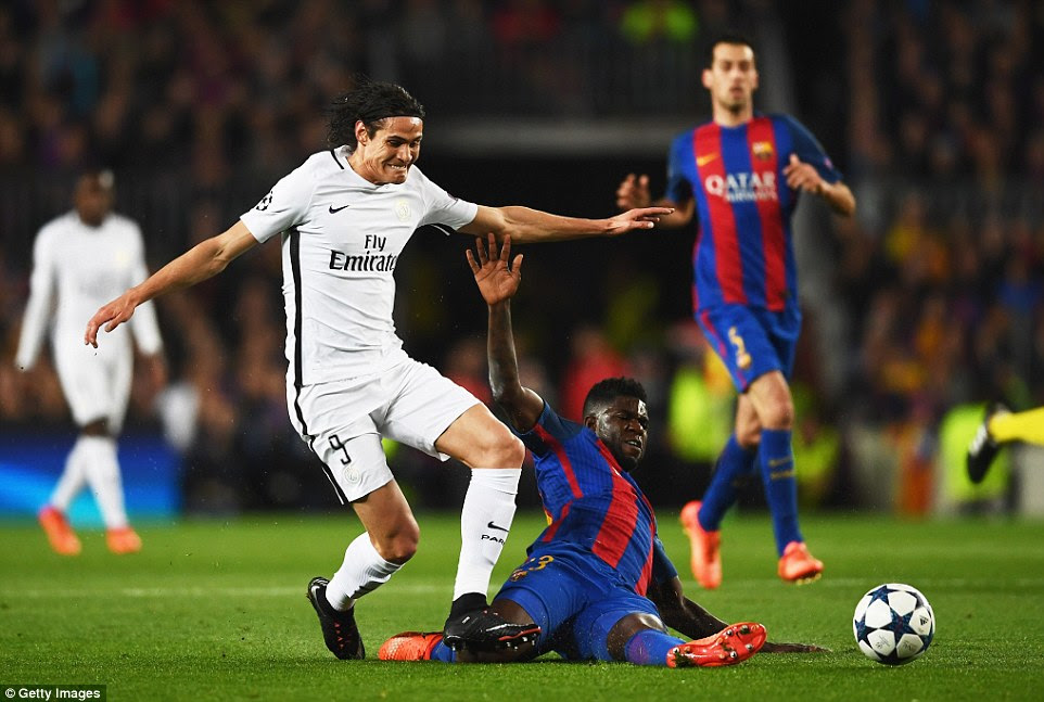 Barcelona centre-back Samuel Umtiti slides in to win the ball from PSG's Uruguayan striker Edinson Cavani