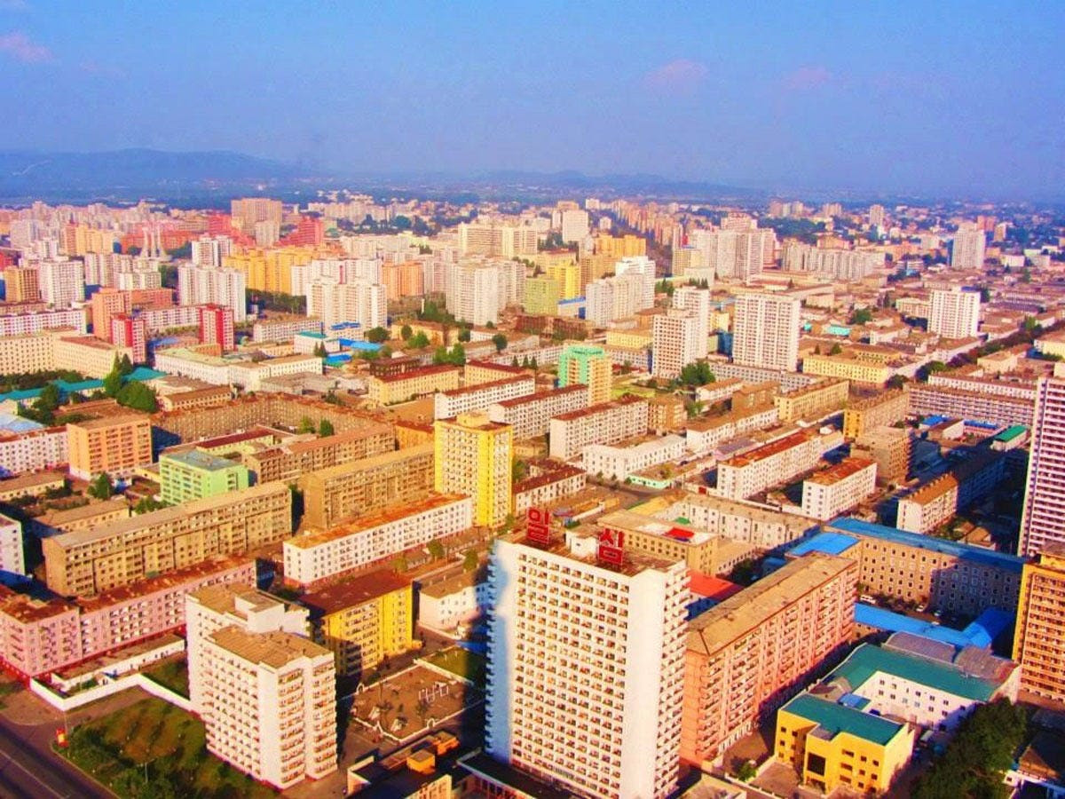 """This shot of the capital city of Pyongyang was taken in-flight. Upon landing, their cameras and phones were searched for GPS capability and their passports were seized until their departure. """"The scariest part of the trip was knowing that no matter what, it was simply impossible at that point to get out of the country, even if we wanted to,"""" Anna said."""