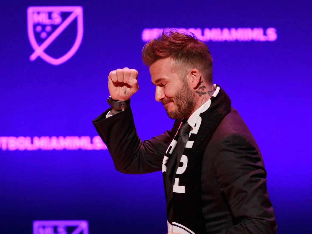 David Beckham, wearing a league scarf, salutes a section of the crowd at this official announcement for Miami's MLS expansion team in Miami, Florida, U.S. January 29, 2018.