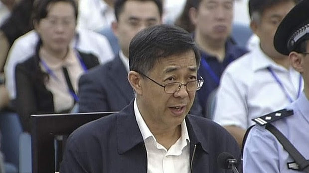 Former Chinese politician Bo Xilai speaks in a court room at Jinan Intermediate People's Court in Jinan.