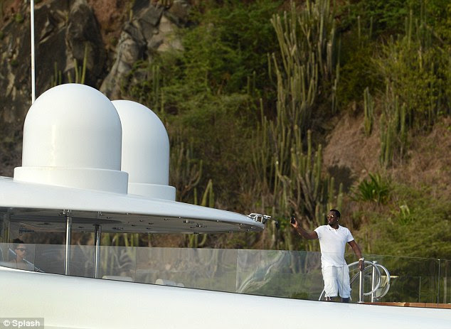 Time for a dip? Diddy stood near his on board pool to capture the images