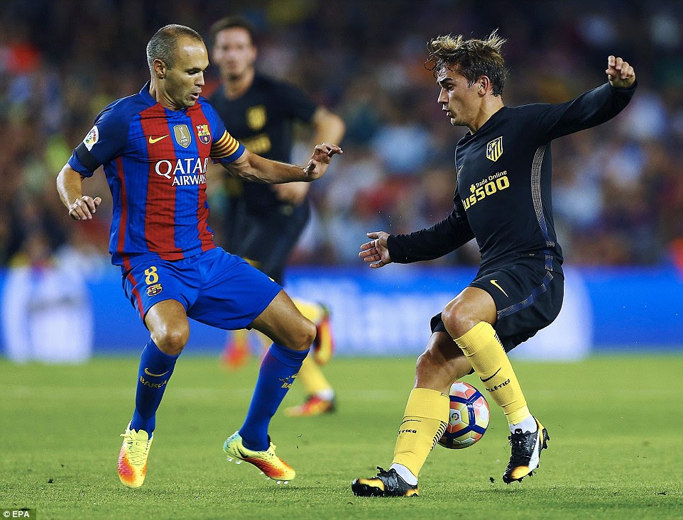Barcelona's Andres Iniesta (left) in action against Antoine Griezmann (right) of Atletico Madrid during the La Liga tie