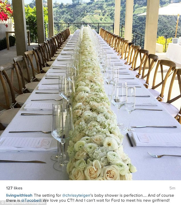 Pretty: The lavish table was decorated with gorgeous white flowers and overlooked the hills
