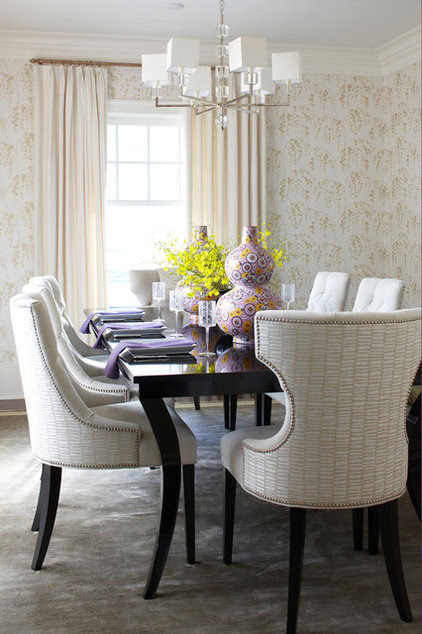 Pair two contrasting fabrics on an upholstered chair to bring edge ...