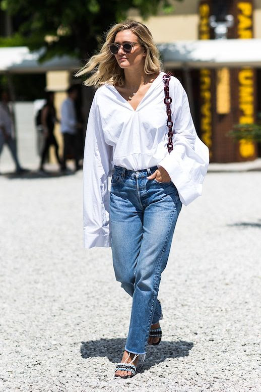 Le Fashion Blog Street Style Wavy Hair Clear Sunglasses White Shirt With Oversized Sleeves Vintage Jeans With Frayed Hems Statement Sandals Via Sandra Semburg