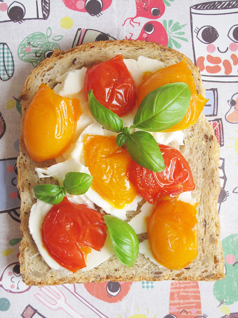 Torn mozzarella, slow-roasted cherry tomatoes and picked basil leaves