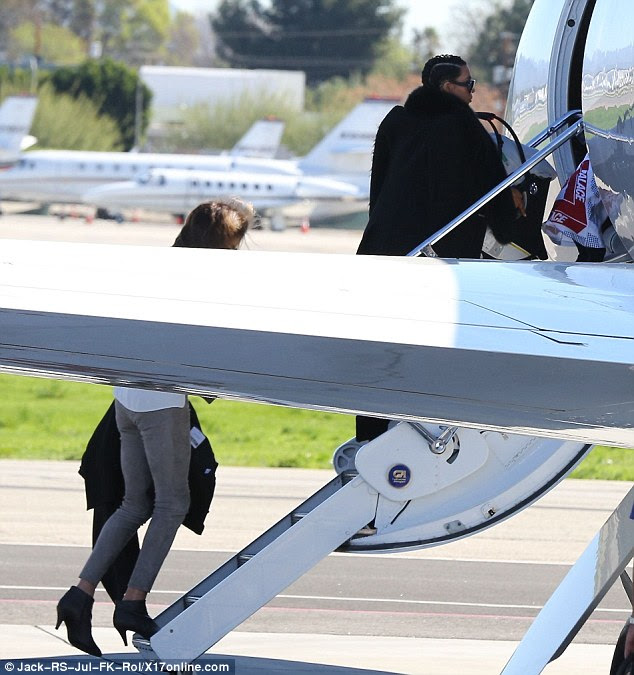 Here we go! Cait followed Kim, Saint and North onto the plane
