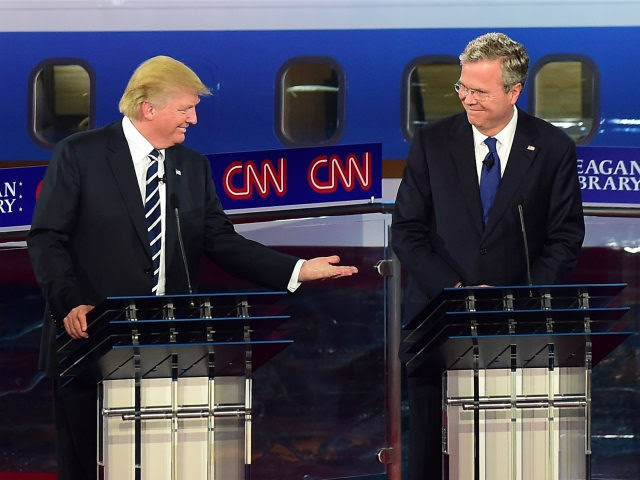 Republican presidential hopefuls, real estate magnate Donald Trump gestures toward former Florida Gov. Jeb Bush (R) during the Republican presidential debate at the Ronald Reagan Presidential Library in Simi Valley, California on September 16, 2015. Republican presidential frontrunner Donald Trump stepped into a campaign hornet's nest as his rivals collectively turned their sights on the billionaire in the party's second debate of the 2016 presidential race. AFP PHOTO / FREDERIC J. BROWN (Photo credit should read FREDERIC J BROWN/AFP/Getty Images)