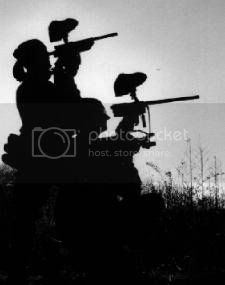 Paintballers in silhouette