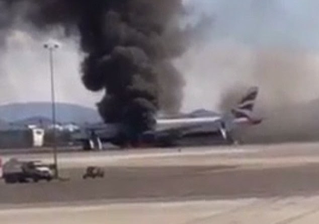 Stills from a video show the evacuation slides deployed at each end of the plane as the smoke rises