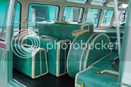vintage blue luggage in voltswagen bus
