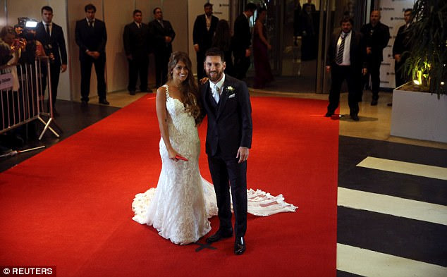 Lionel Messi and Antonella Roccuzzo pose for a photo out on the red carpet on Friday night