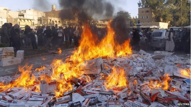 ISIL fighters burning ciagrettes