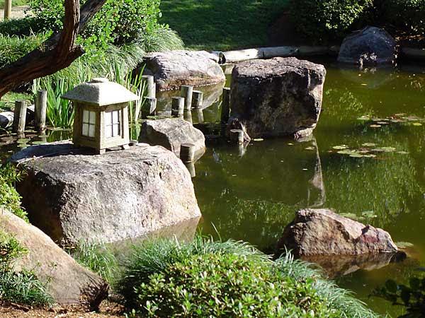 lantern in pond - japanese garden at mt coot-tha botanic gardens