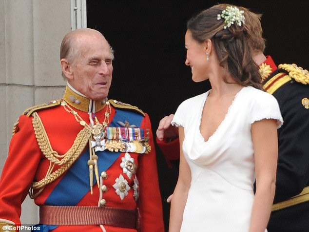 Pippa Middleton and Prince Philip share a joke on the Buckingham Palace balcony after the wedding today
