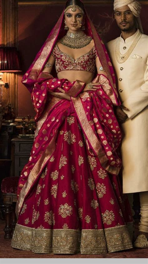 Sabyasachi bride in magenta colour lehenga teamed with
