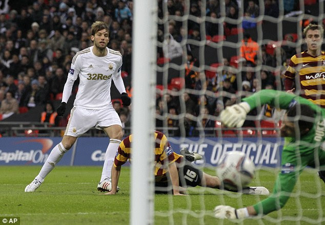 Lethal: Michu doubled Swansea's lead with a deadly accurate strike into the far corner