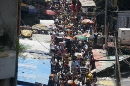People crowd a street in a market in Lagos, which is expected to overtake Cairo soon as Africa's largest city.