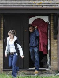 People leave a house in Stratford east London, July 5, 2012. REUTERS/Paul Hackett
