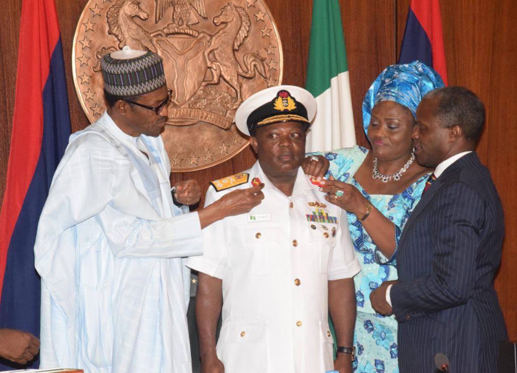 L-R; President Muhammadu Buhari; wife of Chief of Naval Staff, Mrs. Theresa Ibas and Vice President Prof. Yemi Osinbajo Jointly decorating Chief of Naval Staff; Vice Marshal Ibok-Ete Ekwe Ibas with his new Rank during the Decoration Ceremony of the New Service Chiefs at the Presidential Villa Abuja yesterday