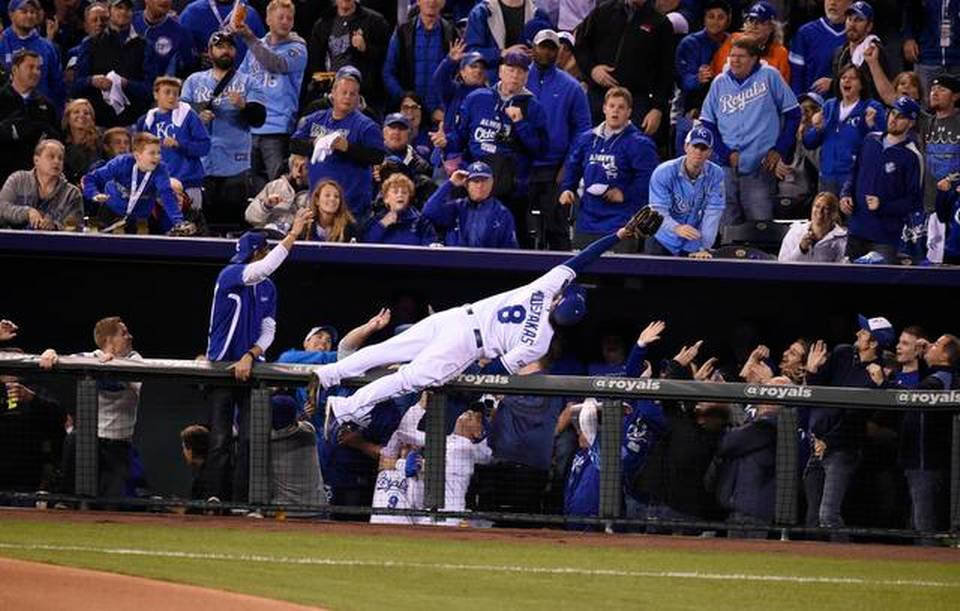 Kansas City Royals third baseman Mike Moustakas went airborne to make a catch on a foul ball hit by Baltimore Orioles Adam Jones in the sixth inning Tuesday at ALCS playoff baseball game on October 13, 2014 at Kauffman Stadium in Kansas City, MO.