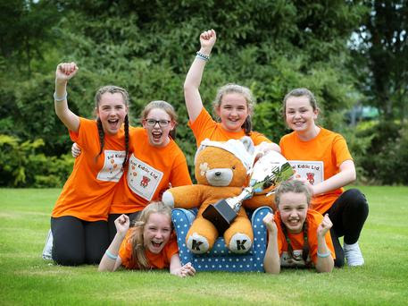"""Sasha Griffin (front left) and Aisling McCauliffe (front right) with (Back left to right) Lauren Shine with Ella Louise Glynn, Niamh Horgan and Kimberly McCarthy, 6th class pupils from Presentation Primary School from Listowel, Co. Kerry who were crowned overall winners of the Bank of Ireland BIZWORLD GRAND FINAL with their """"Kool Kiddies Pack"""" at the grand final held in Athlone Institute of Technology. Photo: Robbie Reynolds"""