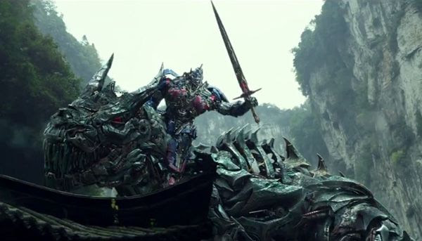 Optimus Prime and Grimlock prepare to ride into battle in TRANSFORMERS: AGE OF EXTINCTION.