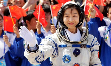Liu Yang, China's first female astronaut, waves during a launch ceremony