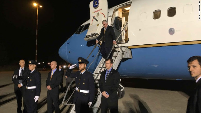 US Secretary of State Rex Tillerson steps off his plane at Pisa Military Airport on Sunday night, arriving for the G7 summit.