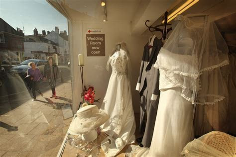 Brides Try On Wedding Dresses At The Red Cross Bridal Wear