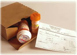 Prescription drug bottles inside a mailed package, along with an Rx