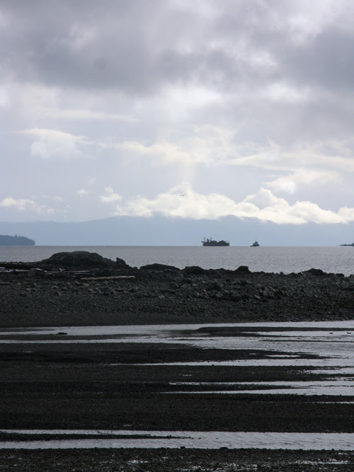a barge in tow, off in the distance, Kasaan Bay, Alaska