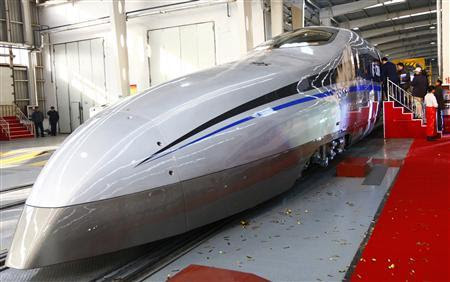 Visitors board a new testing model of a CSR high-speed bullet train during its launching ceremony in Qingdao, Shandong province December 23, 2011. China launched a super-rapid test train over the weekend which is capable of travelling 500 kilometers per hour, state media said on Monday. Picture taken December 23, 2011. REUTERS/China Daily
