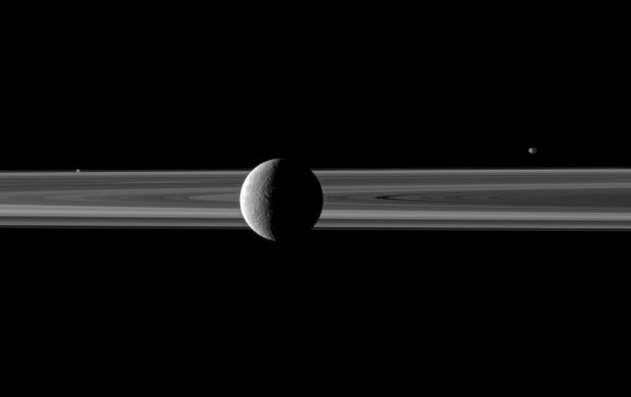 Rhea poses with Saturn's rings; Janus and Prometheus are off in the distance. Credit: NASA/JPL/Space Science Institute. Click for larger version